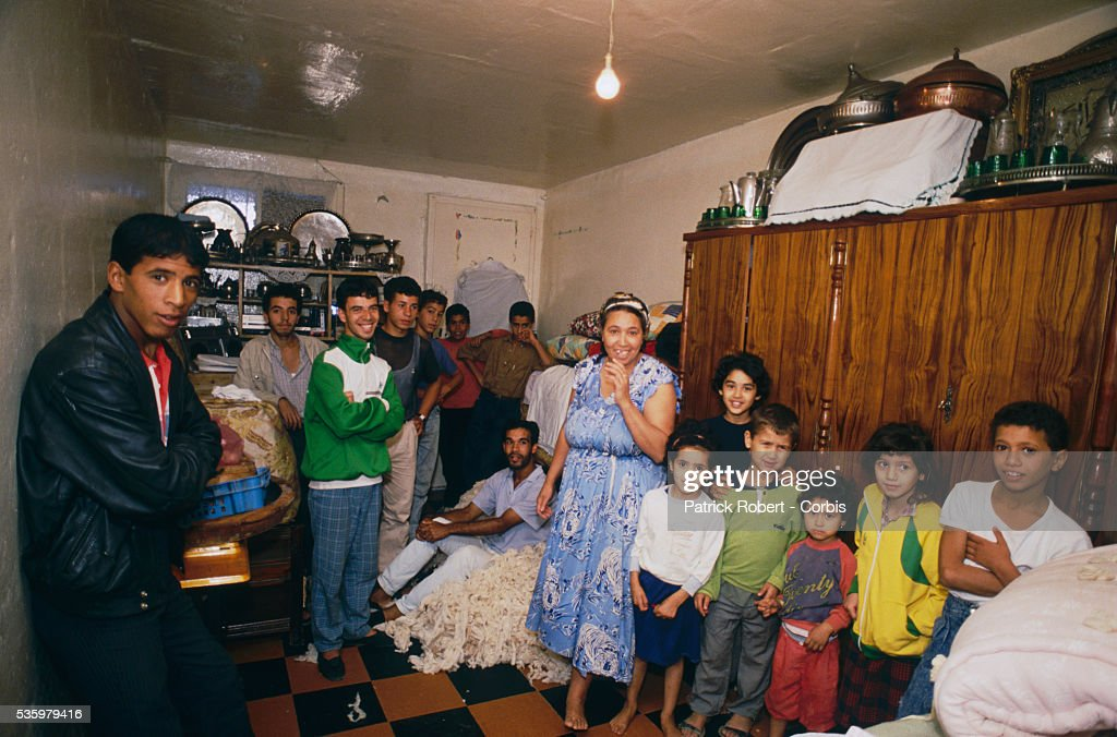 An impoverished Algerian family with 13 children gathers in their living space, measuring 15 square meters, after riots broke out in Algiers, instigated by rising food prices in a country with an unemployment rate of more than 18%. Islamic fundamentalist demonstrations and riots against Algerian President Chadli Bendjedid were severely repressed by the military, which killed hundreds of young urban poor civilians seeking work, decent housing, and public services. The riots were the most serious since Algeria gained independence in 1962.
