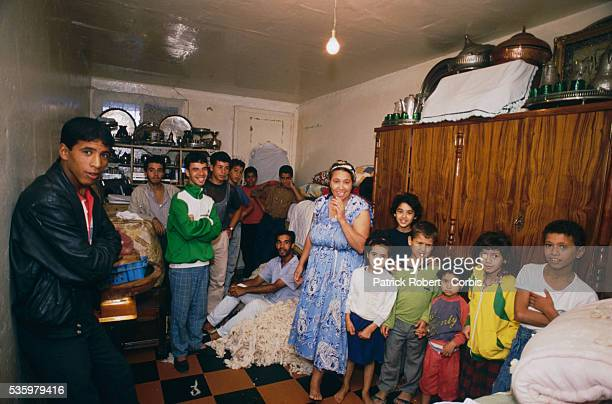 An impoverished Algerian family with 13 children gathers in their living space measuring 15 square meters after riots broke out in Algiers instigated...