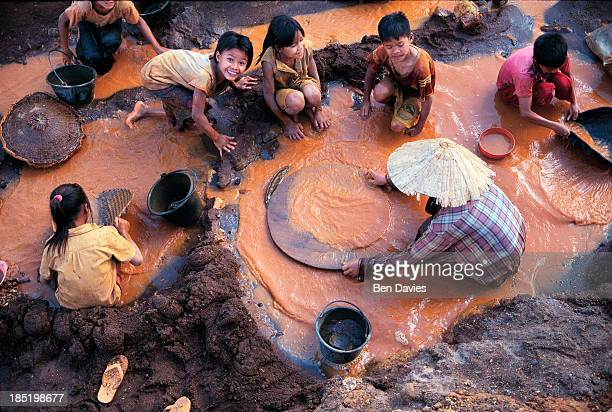 MINE KHAMMOUANE KHAMMOUAN LAOS An impoverished family of tin miners pans the muddy waters outside the Pathene Basin at the Phontiou Tin Mine in...