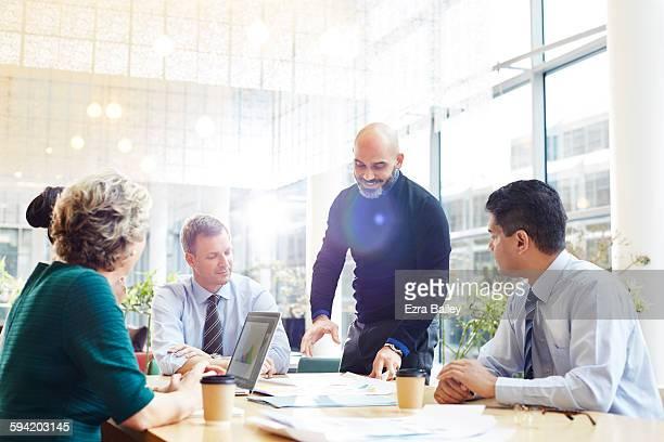 An impromptu brainstorm meeting in modern office.