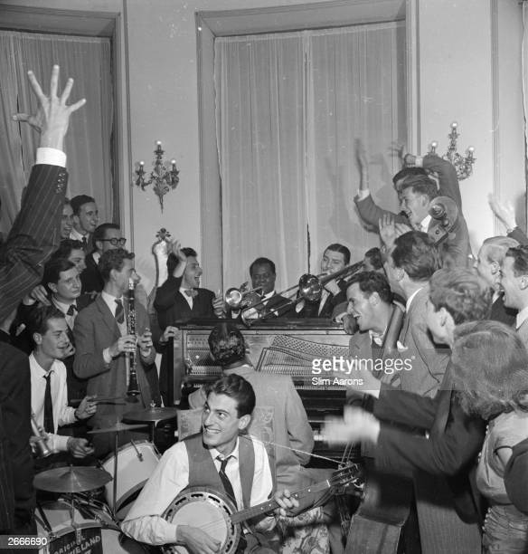 An impromptu concert in Rome with American Jazz trumpeter and singer Louis Armstrong Earl 'Fatha' Hines on piano and Jack Teagarden on trombone...
