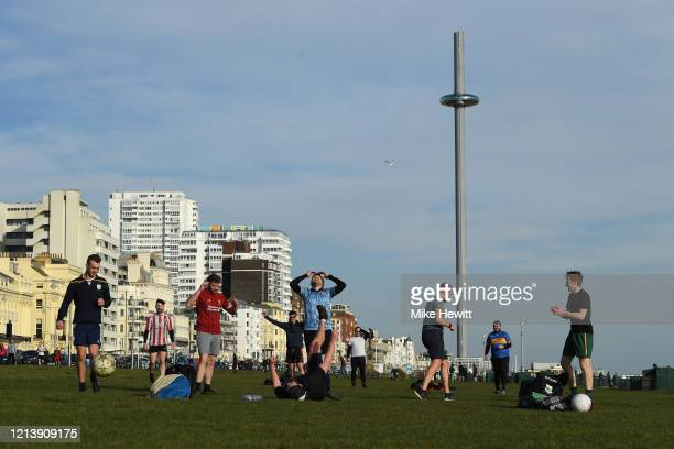 An impromptu game of football takes place on Hove Lawns on March 21 2020 in Hove England Coronavirus has spread to at least 186 countries claiming...