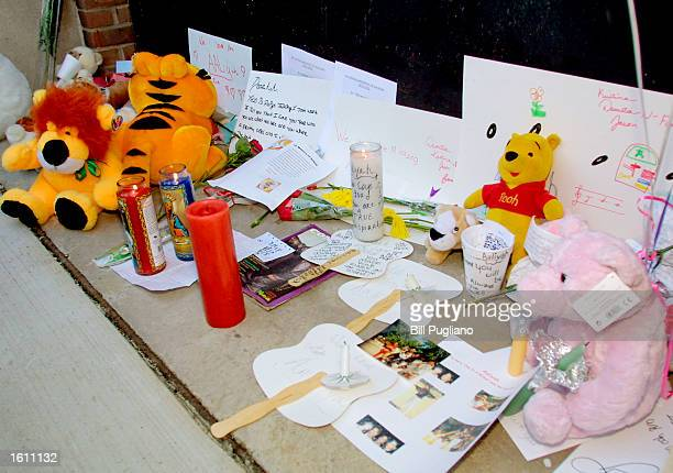 An impromptu memorial for RB singer Aaliyah Haughton sits outside her former school the Detroit High School for Performing Arts August 27 2001 in...