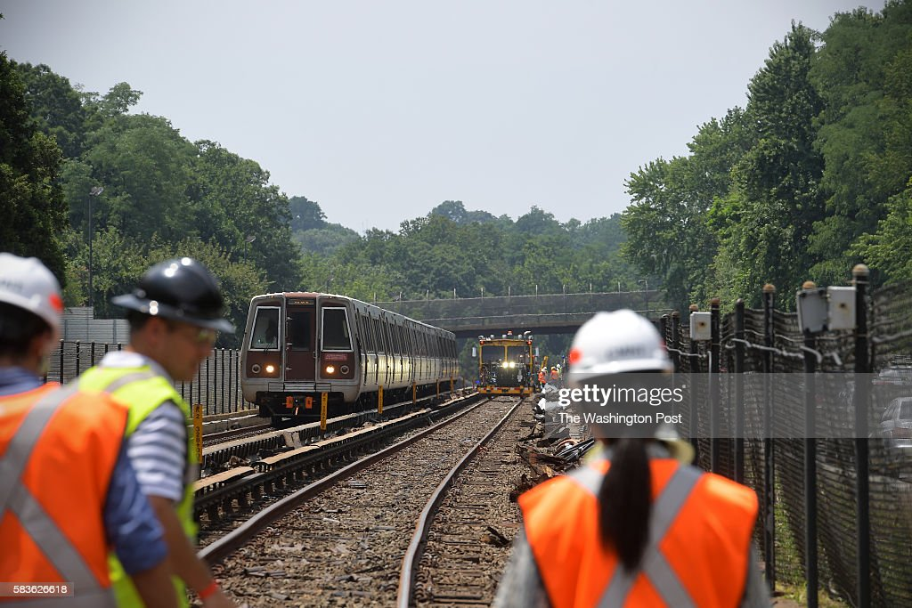 An inbound metro train passes work on the tracks July 22