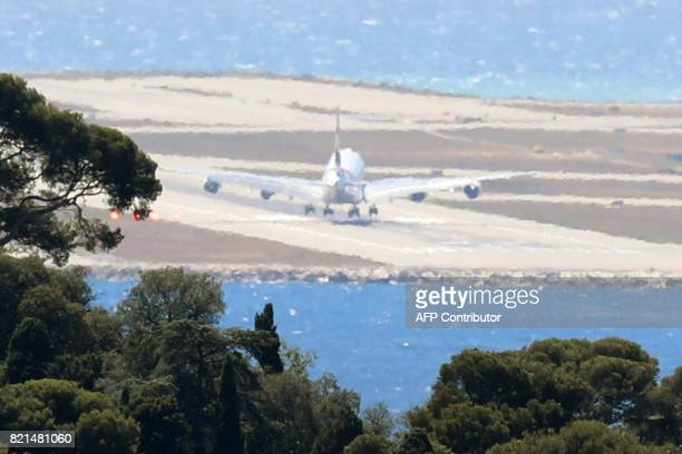 An incoming A380 Airbus of Emirates airline from Dubai lands at Nice airport after a first attempt failed due to strong winds in Nice southern France...