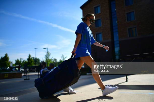 An incoming freshman moves into a campus dormitory at University of Colorado Boulder on August 18, 2020 in Boulder, Colorado. Due to the coronavirus...
