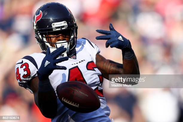An incomplete pass falls through the hands of Corey Moore of the Houston Texans during the second half against the New England Patriots at Gillette...