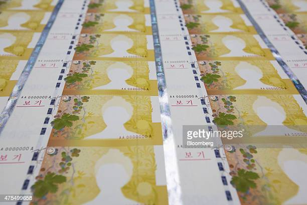 An incomplete print of South Korean 50000 won banknotes is seen at the Korea Minting Security Printing ID Card Operating Corp factory in Geyongsan...