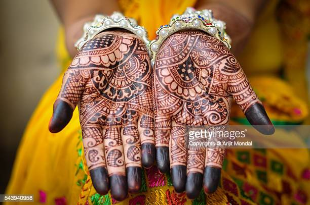 An Indain bride's hand with henna tattoos