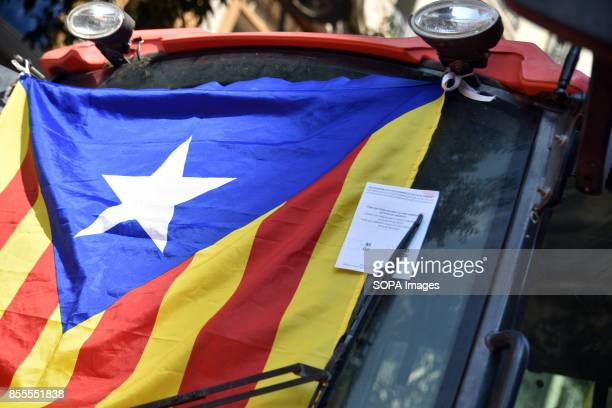 An independence flag of Catalonia is seen during a protest Around 400 tractors called by agricultural unions have gathered on the center of the city...