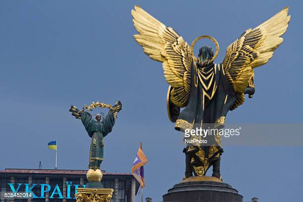 An Independence Monument and StMichael the Archangel statue on a Independence square