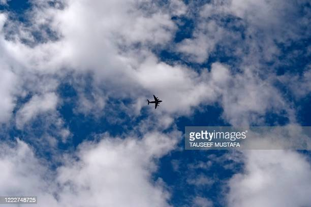 An Indian Air Force aircraft flies over Leh, the joint capital of the union territory of Ladakh, on June 25, 2020. - Indian fighter jets roared over...