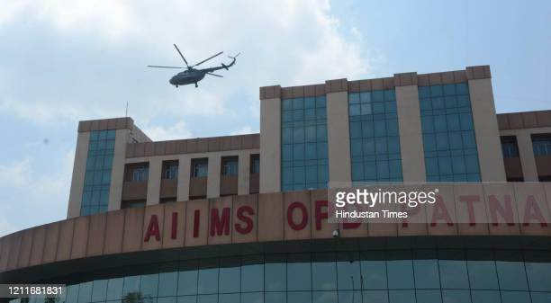 An Indian Air Force chopper approaches to shower flower petals over AIIMS Patna to thank frontline workers engaged against the coronavirus on May 3...