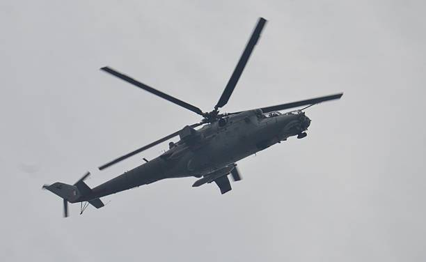 An Indian Air Force chopper flies over the Air Force Base conducting aerial search after the fresh firing and alleged bomb explosion inside the Air...