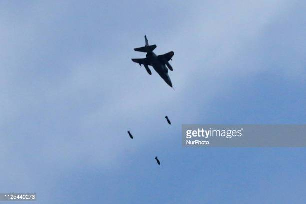 An Indian Air Force fighter aircraft releases bombs during an Indian Air Force excercise named ' Vayu Shakti2019' at the Air Force firing range of...