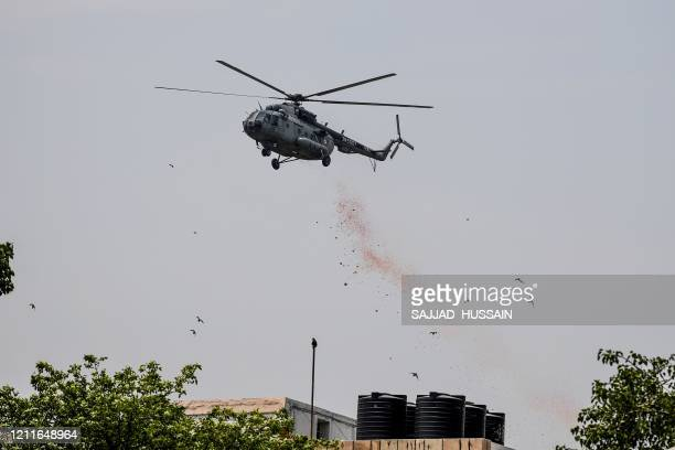 An Indian Air Force helicopter drops rose petals to pay tribute to all the staff of the Safdarjung Hospital and other personnel involved in the fight...