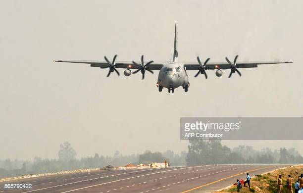 An Indian Air Force Hercules C130J prepares to touch down at the AgraLucknow highway during a touchdown operational exercise by the Indian Air Force...