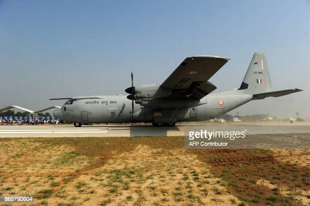 An Indian Air Force Hercules C130J touches down at the AgraLucknow highway during a touchdown operational exercise by the Indian Air Force at Unnao...