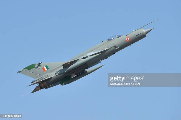 An Indian Air Force MIG21 aircraft Dornier flies during the inaugural day of the fiveday Aero India 2019 airshow at the Yelahanka Air Force station...