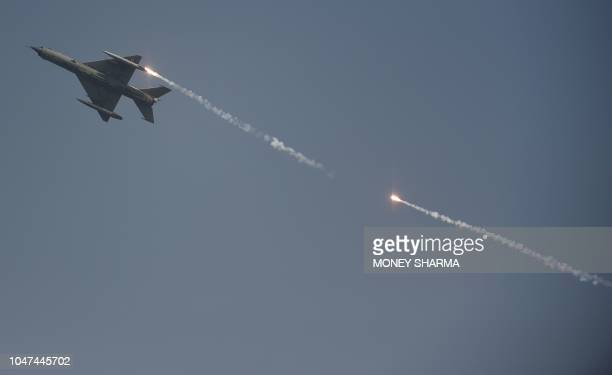 An Indian Air Force MiG-21 fighter jet flies past during the Air Force Day parade at the Air Force station Hindon in Ghaziabad town on the outskirts...