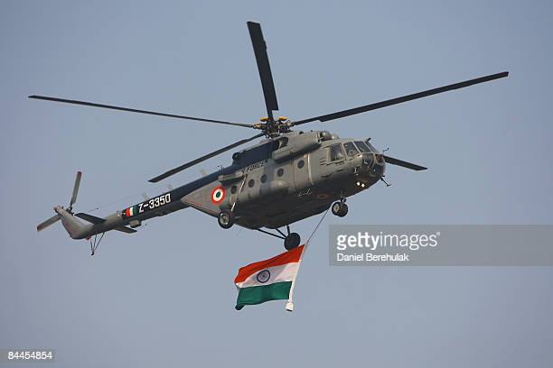 An Indian Air Force military helicopter displays an Indian flag as it flies past during the Republic Day Parade on January 26, 2009 in New Delhi,...