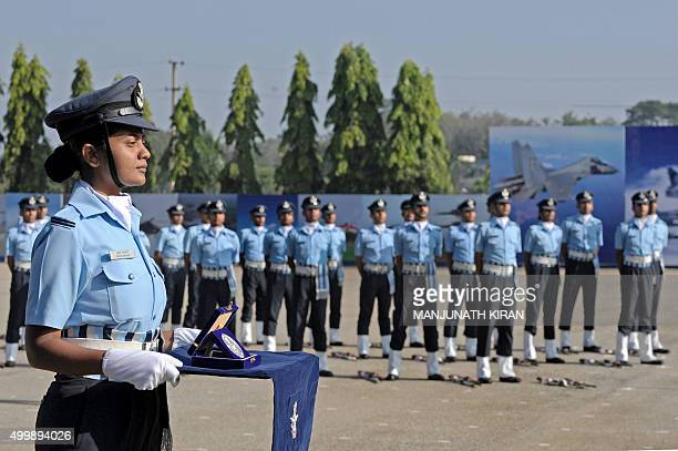 An Indian Air Force officer holds an award to be presented to the highest place student on the Aeronautical Engineering course during a passing out...