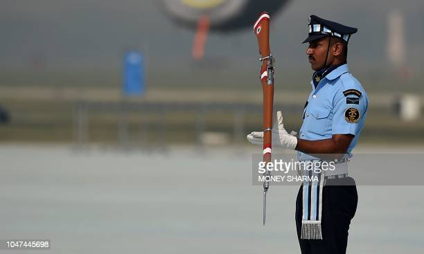 An Indian Air Force personnel performs a drill during the Air Force Day parade at the Air Force station Hindon in Ghaziabad town on the outskirts of...