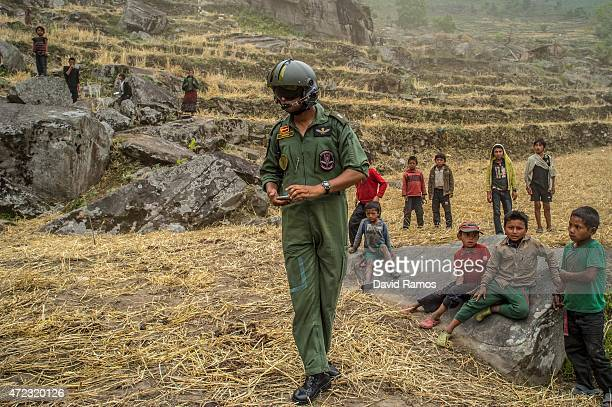 An Indian Air Force pilot supervises an aid dropping operation on May 6 2015 in Hulchuk Nepal A major 79 earthquake hit Kathmandu midday on Saturday...
