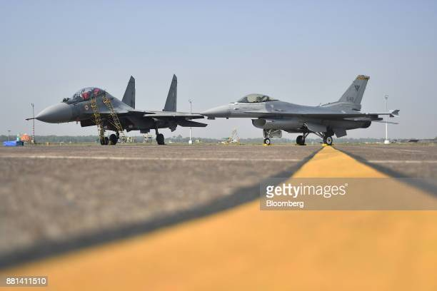 An Indian Air Force Sukhoi fighter jet developed by Sukhoi Aviation Holding Co left and a Republic of Singapore Air Force F16 fighter jet developed...