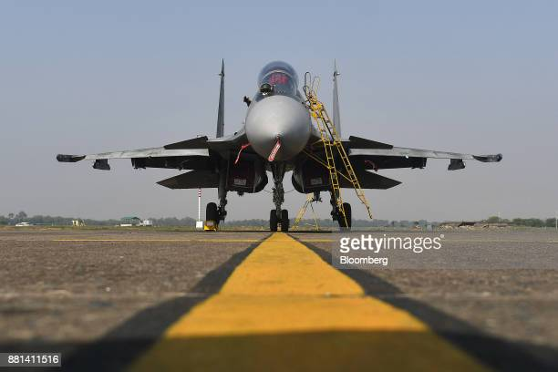 An Indian Air Force Sukhoi fighter jet developed by Sukhoi Aviation Holding Co sits on the tarmac at the Kalaikunda Air Force Station West Bengal...