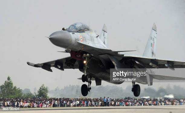 An Indian Air Force Sukhoi Su30MKI fighter jet prepares to touch down at the AgraLucknow highway during a touchdown operational exercise by the...