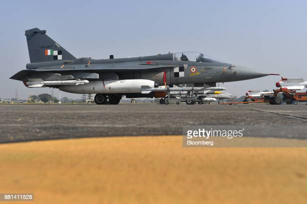 An Indian Air Force Tejas fighter jet developed by Hindustan Aeronautics Ltd sits on the tarmac at the Kalaikunda Air Force Station West Bengal India...
