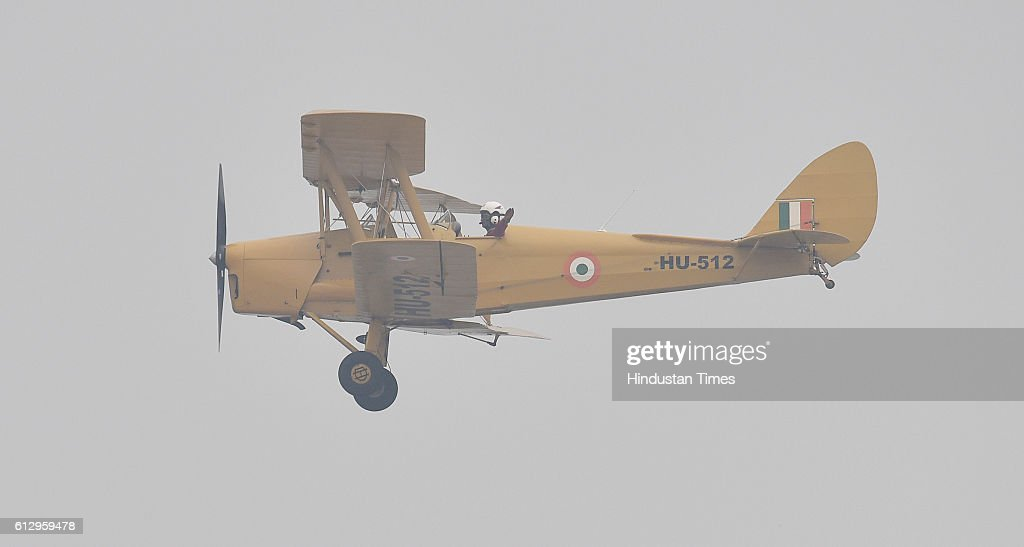 An Indian Air Force Tiger Moth lands after performing during the 84th anniversary of Air Force Day parade rehearsals at the Air Force Station Hindon on October 6, 2016 in Ghaziabad, India. Air Force Day 2016 would be celebrated all over India on Saturday, 8th October.