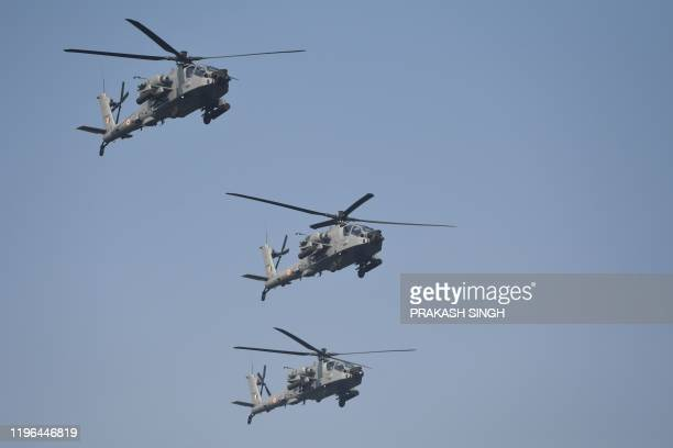 An Indian Air Force's apache helicopters flyover Rajpath during the Republic Day parade in New Delhi on January 26, 2020. - Huge crowds gathered for...