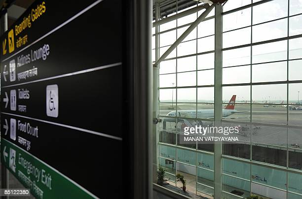 An Indian Airlines aircraft is seen from the lounge of the newly inaugrated domestic departure terminal at the Indira Gandhi International Airport in...