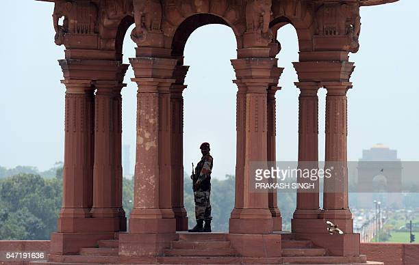 An Indian Army commando stand guards outside the Defence Ministry as Indian Defence Minister Manohar Parrikar meets with Japanese Defence Minister...