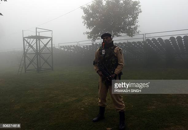 An Indian Army commando stands guard during the full dress rehearsal for the upcoming Indian Republic Day parade on Rajpath on a cold and foggy...