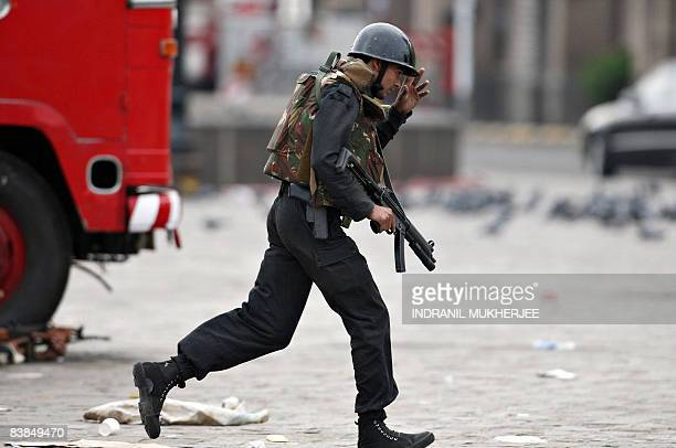 An Indian Army commando takes his position during a gunbattle outside the Taj Mahal hotel in Mumbai on November 28 2008 The Indian military launched...