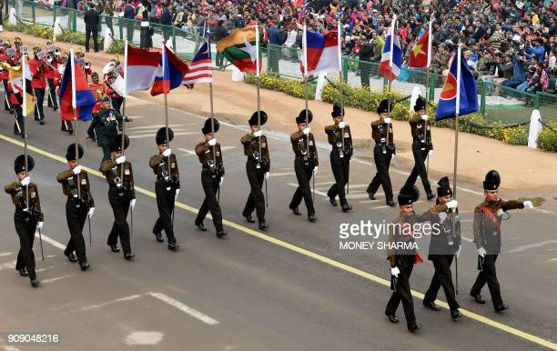 An Indian army contingent marches holding the national flags of the ASEAN countries during the full dress rehearsal for the upcoming Indian Republic...