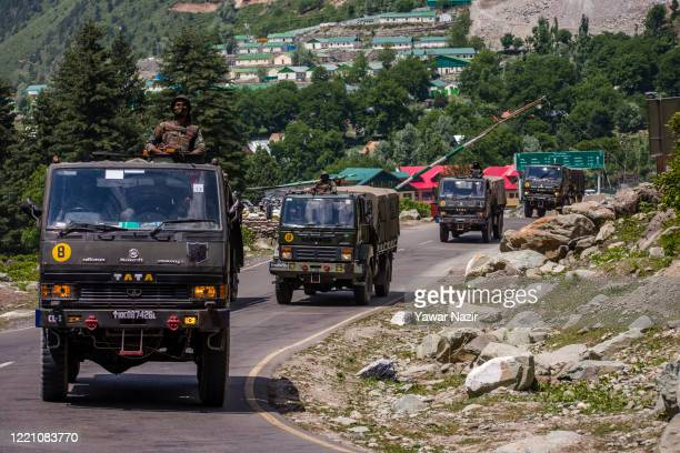 An Indian army convoy drives towards Leh, on a highway bordering China, on June 19, 2020 in Gagangir, India. As many as 20 Indian soldiers were...