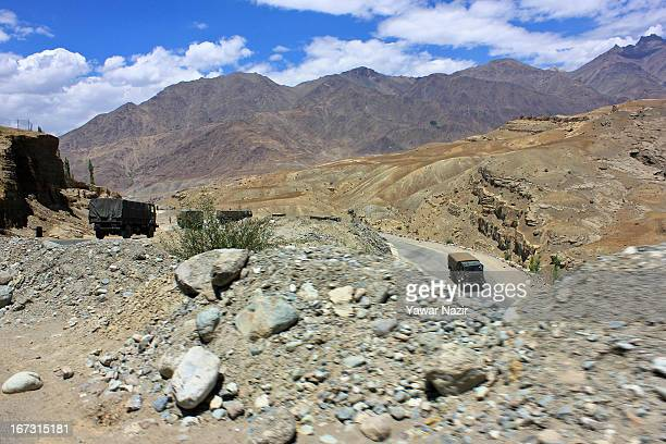 An Indian army convoy moves towards the border in Pangong a disputed territory between India and China on August 2 2012 in Ladakh Indianadministered...