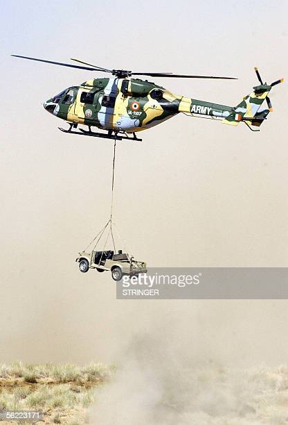 An Indian army helicopter lowers a jeep to the ground during the 'Operation Desert Strike' Exercise at Pokhran some 550kms southwest of New Delhi18...