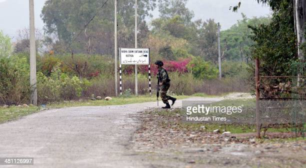 An Indian army jawan moving towards encounter site during an encounter with terrorists at Janglote village on March 28 2014 in Kathua about 80 km...