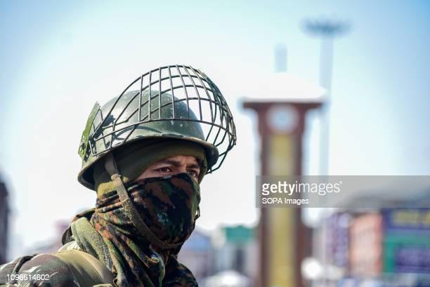 SRINAGAR KASHMIR INDIA SRINAGAR JAMMU KASHMIR INDIA An Indian Army man seen looking on as he stands guard during restrictions in Srinagar Restriction...