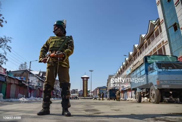 SRINAGAR KASHMIR INDIA SRINAGAR JAMMU KASHMIR INDIA An Indian Army man seen looking on as he stands guard near clock tower during restrictions at the...