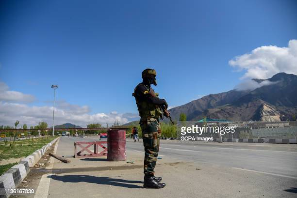 An Indian army man seen standing alert to safeguard the movement of Indian convoys at the National Highway on the outskirts of Srinagar The Indian...