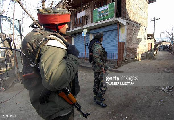 An indian army military police with Indian army soldier guard the entry point to the village of Balpora in central Budgam district, where encounter...