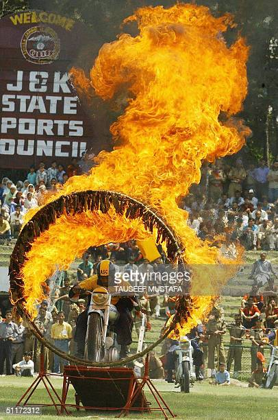 An Indian army motorcycle display rider performs during a ceremony to celebrate India's 57th Independence Day at the Bakshi Stadium in Srinagar 15...