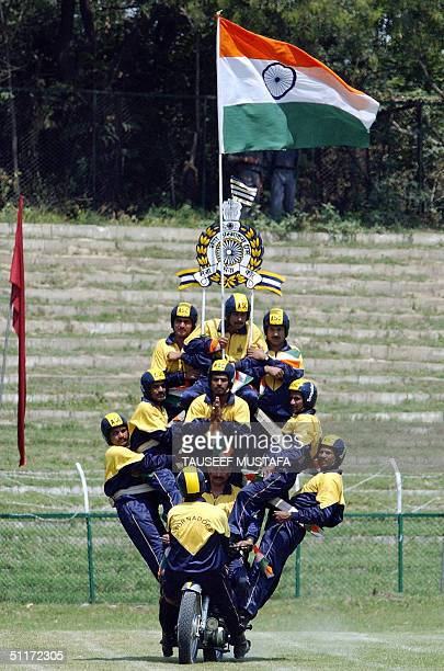 An Indian army motorcycle display team perform during a ceremony to celebrate India's 57th Independence Day at the Bakshi Stadium in Srinagar 15...