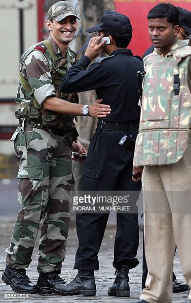 An Indian army officer congratulates an Indian National Security Guard commando after their successful operation at The Taj Mahal hotel in Mumbai on...